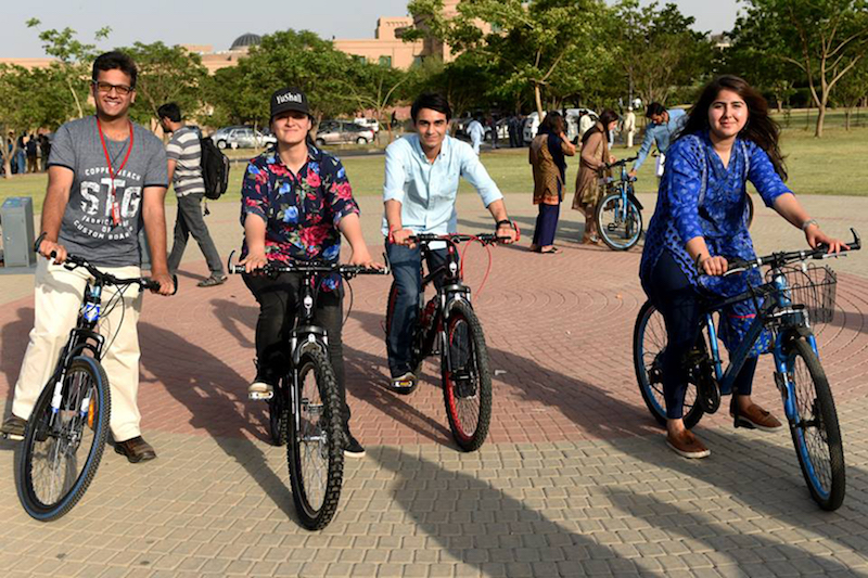 A group of students riding bikes at the soft launch of CYKIQ at NUST campus, Islamabad. PHOTO: REUTERS
