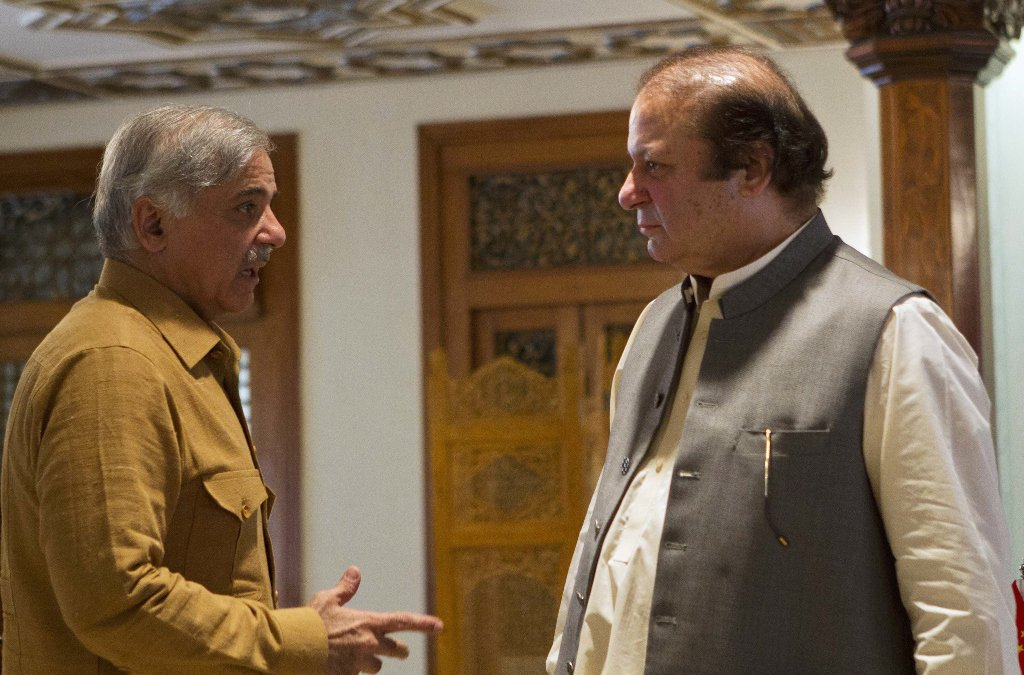 Former prime minister Nawaz Sharif (R) with his brother Shehbaz Sharif. PHOTO: REUTERS