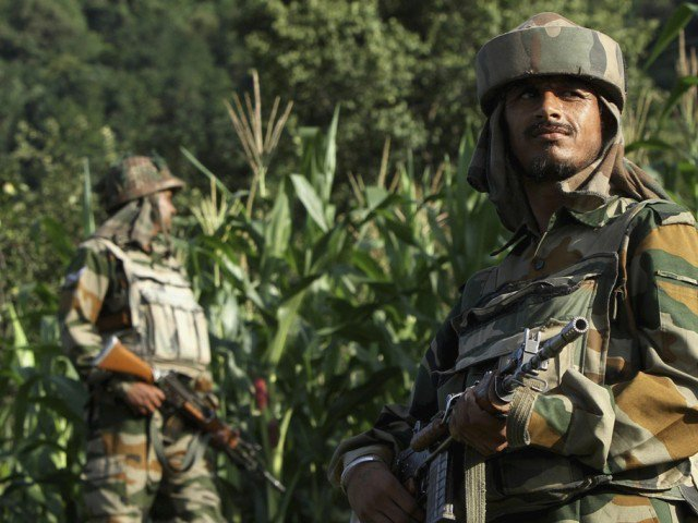 Indian army soldiers patrol near the Line of Control, a ceasefire line dividing Kashmir between India and Pakistan, in Poonch district in this August 7, 2013 file photo. PHOTO: REUTERS