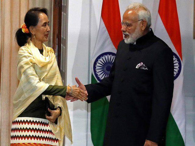 Myanmar's State Counsellor Aung San Suu Kyi shakes hands with India's Prime Minister Narendra Modi during a photo opportunity ahead of their meeting at Hyderabad House in New Delhi, India. PHOTO: REUTERS