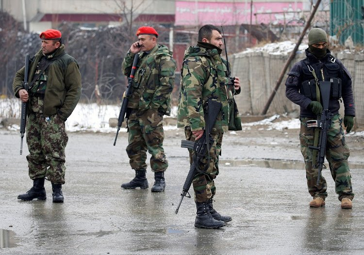 Afghan National Army (ANA) soldiers stand guard at the entrance gate of Marshal Fahim military academy in Kabul, Afghanistan. PHOTO: REUTERS