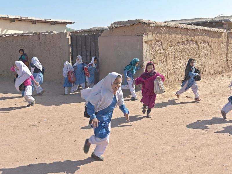 Children rush out of school. PHOTO: REUTERS