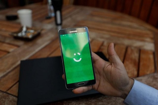 An employee shows the logo of ride-hailing company Careem on his mobile in his office in the West Bank city of Ramallah July 17, 2017. Picture taken July 17, 2017. PHOTO: REUTERS