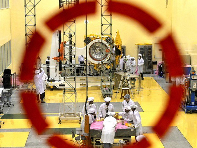In this file picture taken on September 11, 2013, scientists and engineers work on PHOTO:EXPRESS