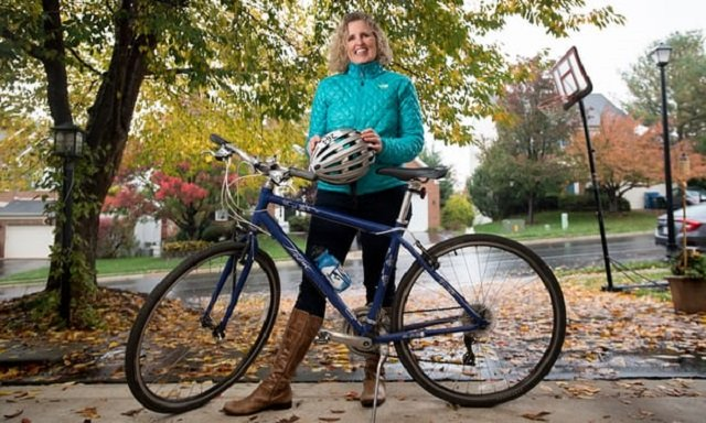 Juli Briskman with her bicycle. PHOTO: GUARDIAN