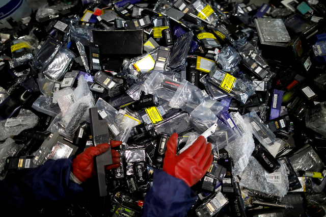 An employee sorts out old batteries at an urban mining plant in Gunsan April 2, 2018.  PHOTO: REUTERS