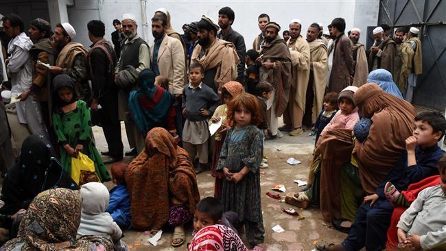 Afghan refugees gather for renewal of their family cards at the Chamkany registration center on the outskirts of Peshawar. PHOTO: AFP