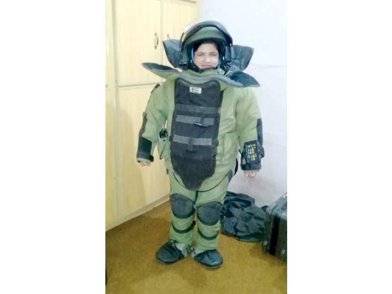 Constable Atia Batool in bomb disposal suit. PHOTO: EXPRESS