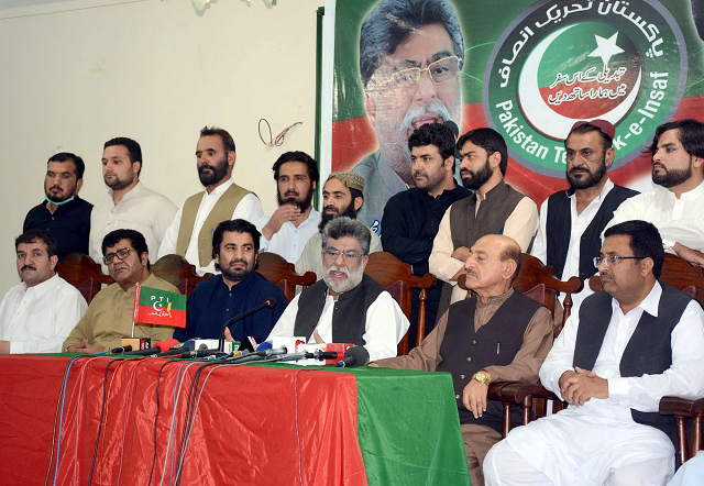 PTI Provincial President Yar Muhammad Rind addressing a press conference after former provincial minister Shahnawaz Marri and others joined the party. PHOTO: EXPRESS