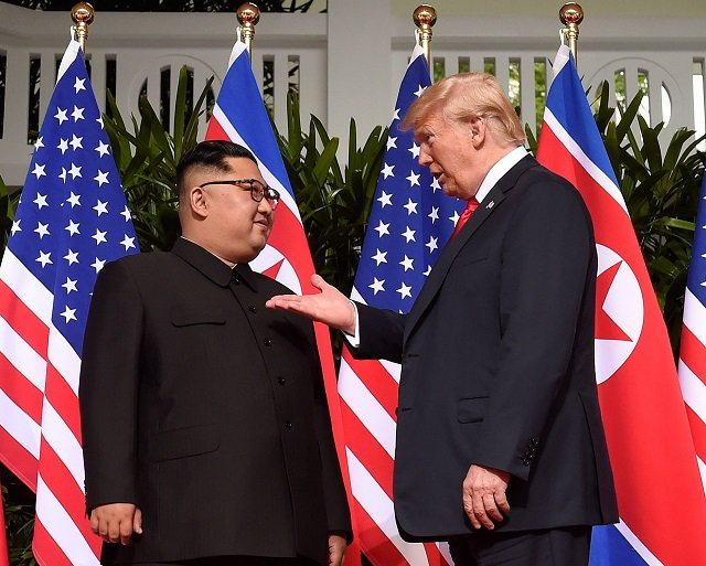 US President Donald Trump gestures as he meets North Korea's leader Kim Jong Un at the start of their historic US-North Korea summit, at the Capella Hotel on Sentosa island in Singapore on June 12, 2018. PHOTO: AFP
