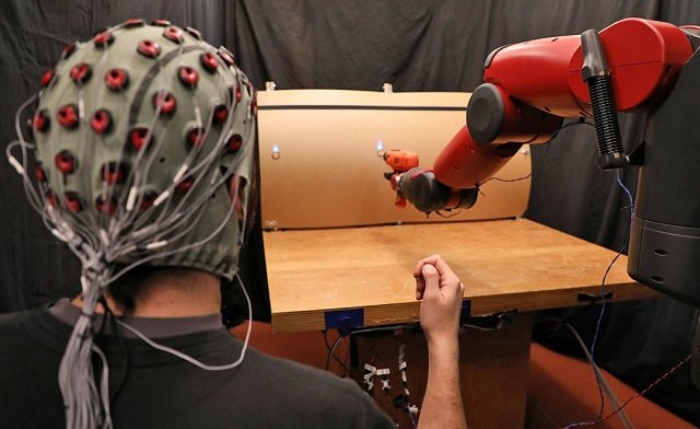 The robot responds to hand gestures from the person. PHOTO: MIT