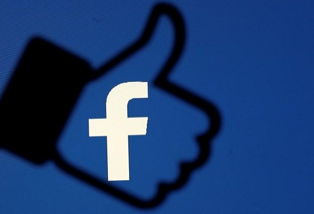 FILE PHOTO: A 3D-printed Facebook like button is seen in front of the Facebook logo. PHOTO: REUTERS
