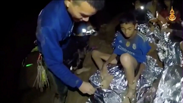 Boys from the under-16 soccer team trapped inside Tham Luang cave greet members of the Thai rescue team in Chiang Rai, Thailand, in this still image taken from a July 3, 2018 video by Thai Navy Seal. Thai Navy Seal/Handout via REUTERS TV