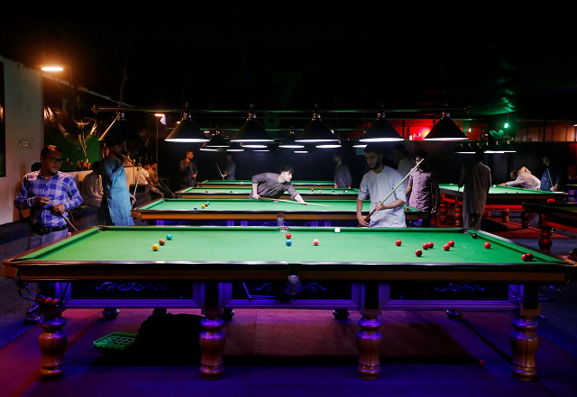 Afghan youth play snooker in Kabul.  PHOTO:REUTERS