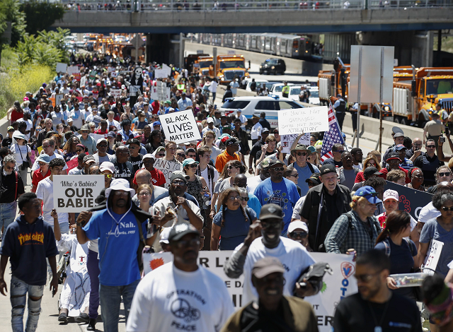 Protesters partially shut down a Chicago Expressway to protest gun violence. PHOTO: AFP.