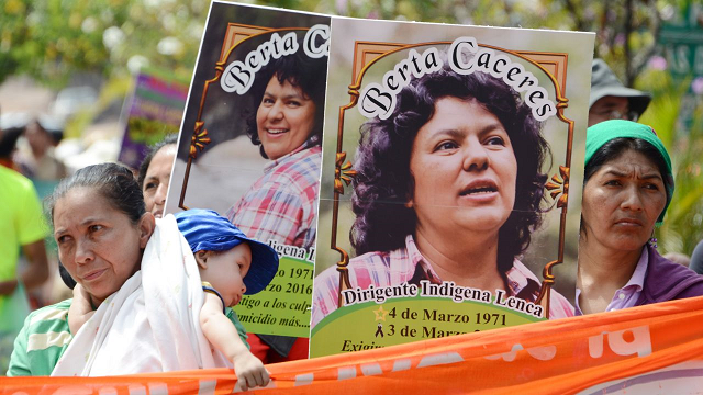 Banners at a protest for slain environmentalist. PHOTO: AFP.