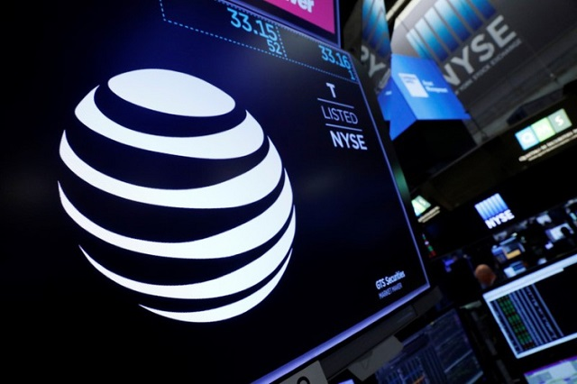 The AT&T logo is seen on a monitor on the floor of the New York Stock Exchange (NYSE) in New York City, US June 13, 2018. PHOTO: REUTERS