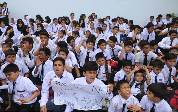Students of a private school protest against sealing of their school. PHOTO: ONLINE