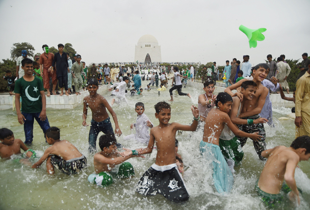 Karachiites, young and old, celebrated Independence Day with much zeal and zest across the city. PHOTO: AFP