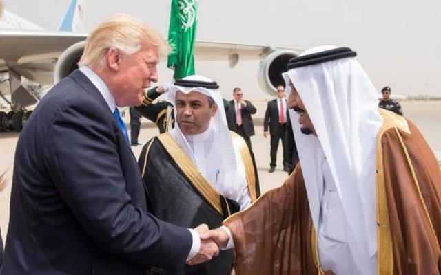 Saudi Arabia's King Salman bin Abdulaziz Al Saud shakes hands with US President Donald Trump during a reception ceremony in Riyadh, Saudi Arabia. PHOTO: REUTERS