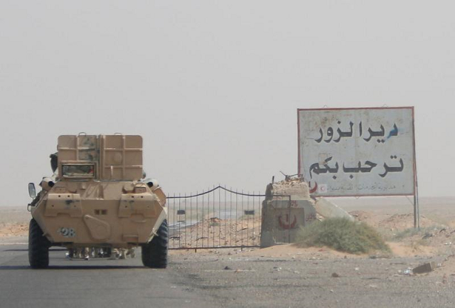 An armoured vehicle drives through oilfield. PHOTO: REUTERS