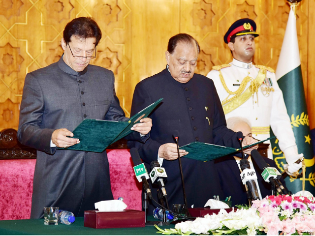 Imran was administered the oath by President Mamnoon Hussain during a ceremony at the President House in Islamabad. PHOTO: AFP