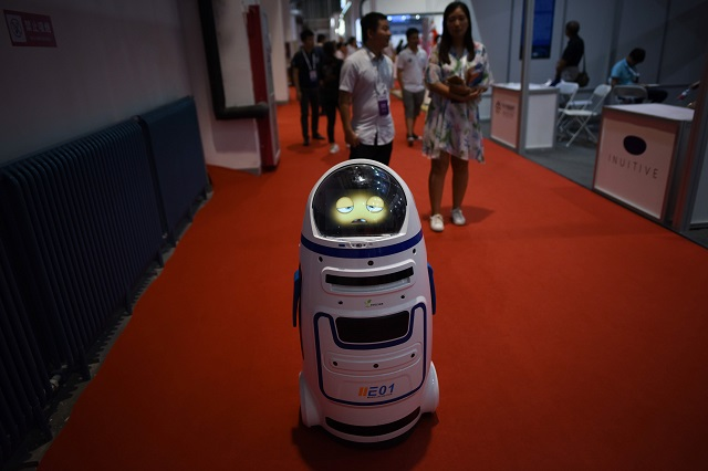 """(FILES) This file photo taken on August 15, 2018 shows a robot moving at the 2018 World Robot Conference in Beijing. - The popular stars of this year's World Robot Conference, which ends on August 19, 2018, were undoubtedly the small, amateur-made """"battle bots"""" which smashed, hammered and sawed their way through their opponents to a cacophony of cheers and shouts from a rapt audience. PHOTO: AFP"""