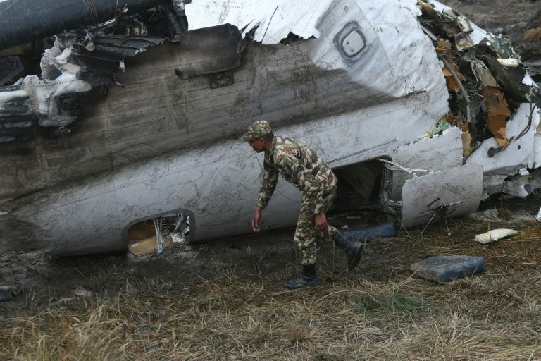 The wreckage of the airplane that crashed near the international airport in Kathmandu in March: an official report has blamed the pilot PHOTO: AFP