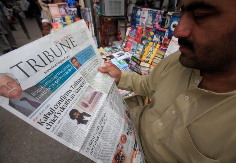 A man reads a newspaper containing news. PHOTO: REUTERS