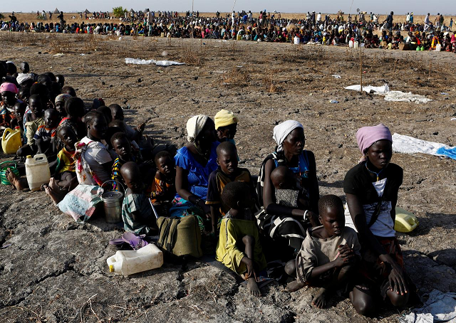Women and children wait to be registered prior to a food distribution carried out by the United Nations World Food Programme (WFP) in Thonyor, Leer state, South Sudan, February 26, 2017. PHOTO: REUTERS