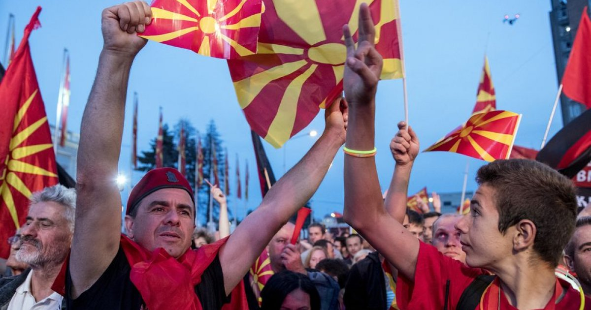 Supporters of the biggest opposition party, conservative VMRO-DPMNE wave flags during a protest in front of a Government building PHOTO: AFP