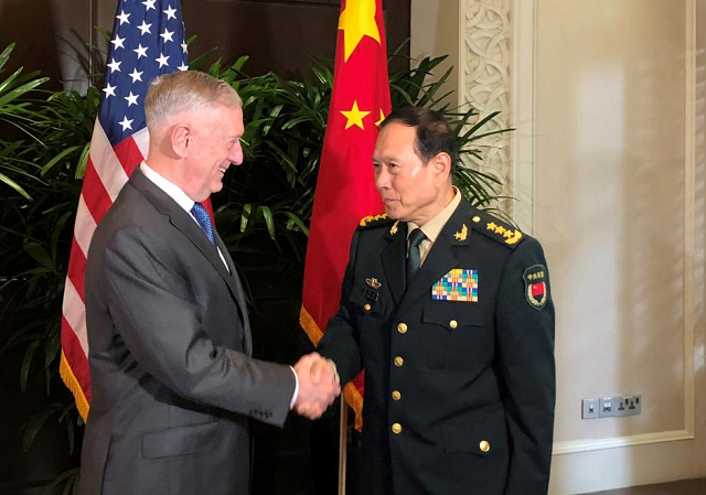 US Defense Secretary Jim Mattis and China's Defense Minister Wei Fenghe greet each other ahead of talks in Singapore, October 18, 2018. PHOTO: REUTERS