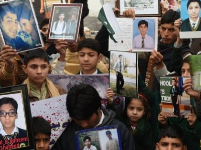 Relatives of schoolchildren killed in a Taliban attack on the Army Public School (APS) protest against delays in the investigation in Peshawar. PHOTO: AFP