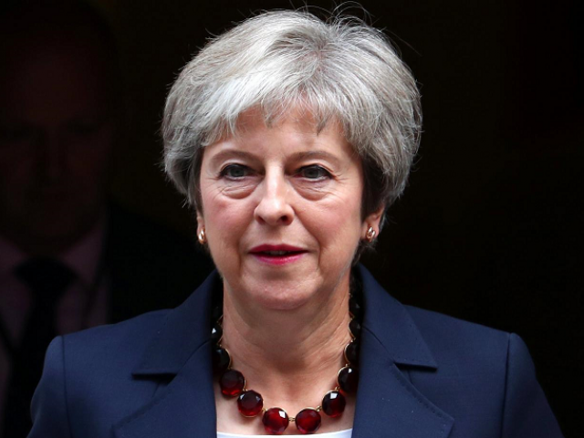 Prime Minister Theresa May is fighting to defend a draft deal agreed with the EU.  PHOTO: FILE