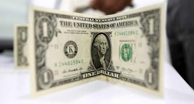 A close-up shot of a dollar bill. PHOTO: AFP