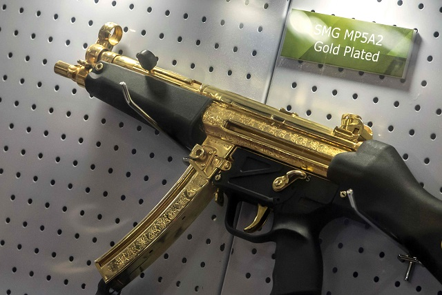 1.A gold plated weapon is displayed at the Pakistani stand during Egypt s first Service Defence Exhibition in Cairo on December 3, 2018, at the International Exhibition Center PHOTO: AFP