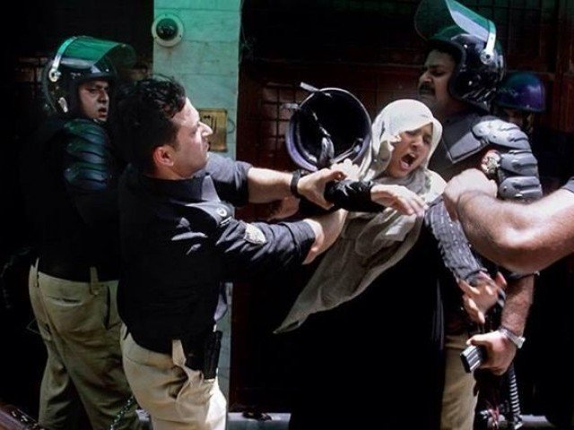 Back in June of 2014, 14 Pakistan Awami Tehreek (PAT) workers were killed and dozens were injured in a police operation on PAT supporters gathered outside the residence of Tahirul Qadri in Lahore's Model Town. PHOTO: EXPRESS/FILE