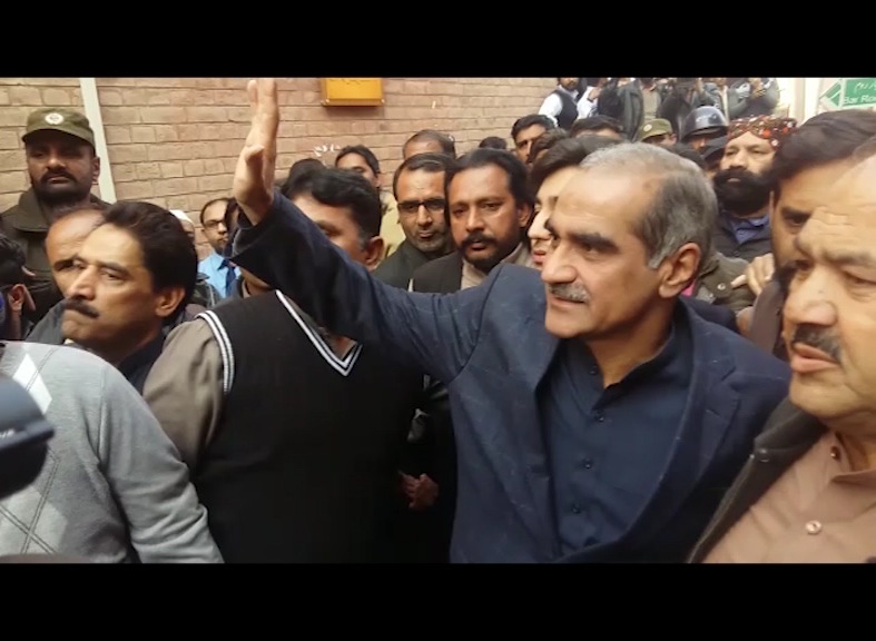 Saad Rafique being escorted from court premises. Photo: EXPRESS