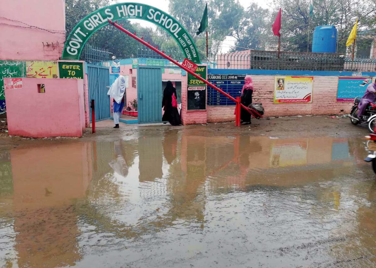 Rainwater accumulated in front of a school in Sargodha. PHOTO: APP