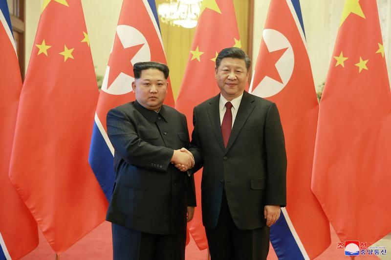 North Korean leader Kim Jong Un shakes hands with Chinese President Xi Jinping in Beijing. PHOTO: REUTERS