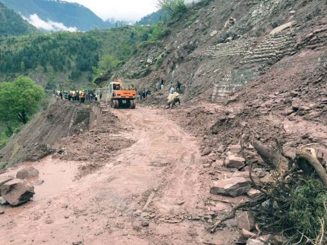 Efforts underway to recover remaining four labourers still trapped under the rubble at Karakoram Highway. PHOTO: FILE
