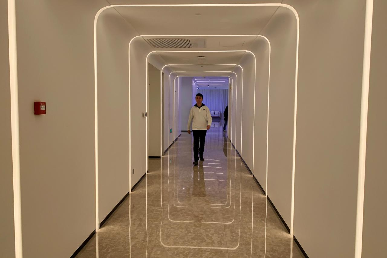 A staff member walks in the hallway during a demonstration to the media at Alibaba Group's futuristic FlyZoo hotel in Hangzhou, Zhejiang province, China. PHOTO: REUTERS