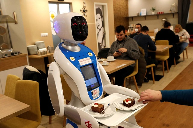 A robot waiter serves customers at a cafe in Budapest, Hungary, January 24, 2019. PHOTO: REUTERS