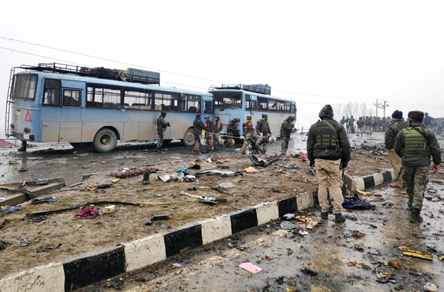 Indian soldiers examine the debris after an explosion in occupied Kashmir's Pulwama district on Thursday. PHOTO: REUTERS