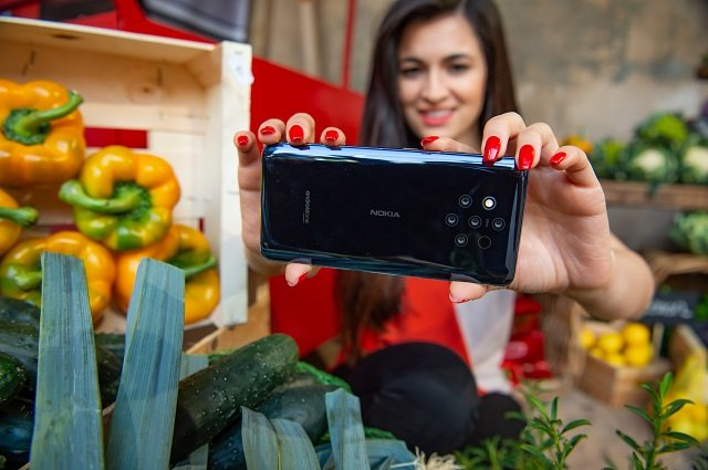 Staff member Maria Arbalova demonstrates the Nokia 9 Pureview phone at the launch of the new range of Nokia handsets. PHOTO: NOKIA