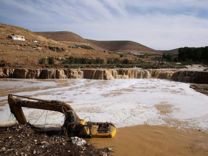 An excavator is partially submerged in a stream after rain storms unleashed flash floods, in Madaba city, near Amman, Jordan, November 10, 2018. PHOTO: REUTERS