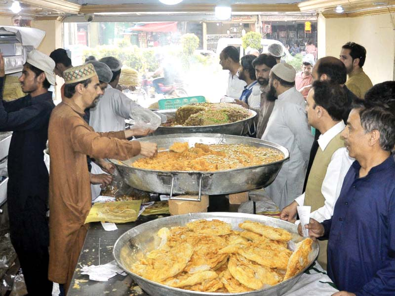 People buying sweets on the eve of Shab-e-Bharat, while police show seized fireworks. PHOTOS: EXPRESS/ AGENCIES