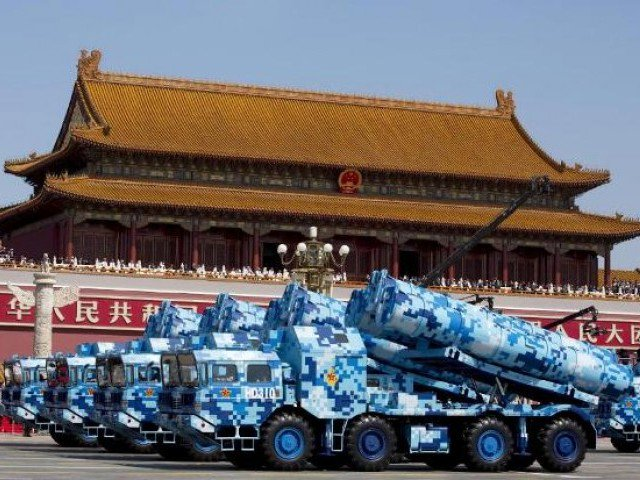 Military vehicles carry cruise missiles during a military parade in Beijing. FILE PHOTO: Reuters