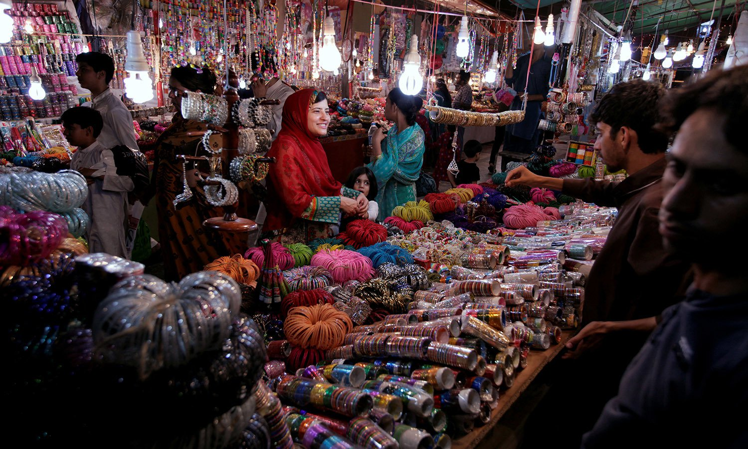 A woman buy bangles and jewellery at a stall ahead of Eid al-Fitr in Islamabad. PHOTO: REUTERS