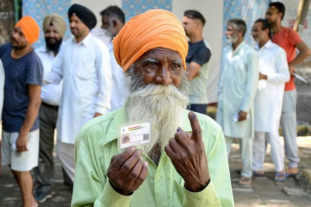 Indian voter Ajeet Singh shows his ink-marked finger after casting his vote during the 7th and final phase of India's general election at a polling station in a village on the outskirts of Amritsar on May 19, 2019. PHOTO: AFP
